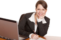 Business woman sitting in office signing contract Stock Images