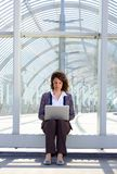 Business woman sitting outside using laptop Royalty Free Stock Photo