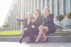 Business woman sitting outside Stock Photography