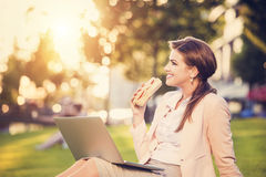 Business woman sitting in a park Stock Photography