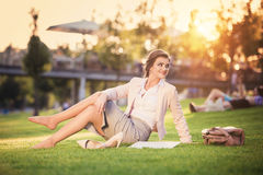 Business woman sitting in a park Stock Images