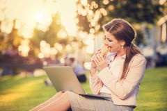 Business woman sitting in a park Royalty Free Stock Image