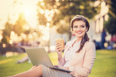 Business woman sitting in a park Stock Image