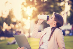 Business woman sitting in a park Royalty Free Stock Photo