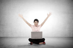 Business woman sitting and play with her laptop Stock Image