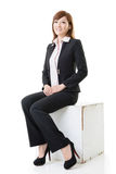 Business woman sitting position Stock Photos