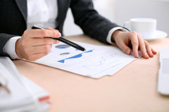 Business woman sitting at the table and examines the financial results Stock Photo