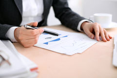 Business woman sitting at the table and examines the financial results Stock Image