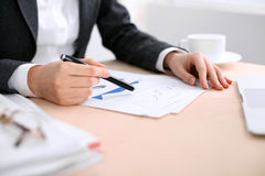 Business woman sitting at the table and examines the financial results Royalty Free Stock Photo