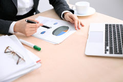 Business woman sitting at the table and examines the financial results Stock Images