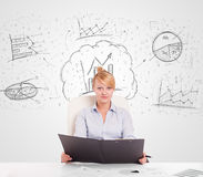 Business woman sitting at table with hand drawn graph charts Royalty Free Stock Images