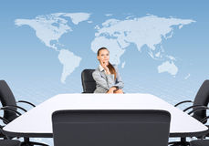 Business woman sitting at table Royalty Free Stock Photos