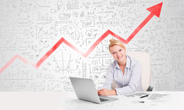 Business woman sitting at table with market diagrams Stock Images