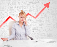 Business woman sitting at table with market diagrams Stock Image