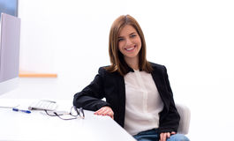 Business woman sitting at the table in office Stock Photography