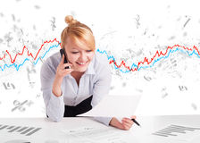 Business woman sitting at table with stock market graph Stock Image
