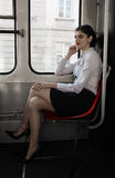 Business woman sitting in the tram stock images