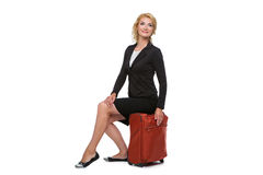 Business woman sitting on travel case Stock Photos
