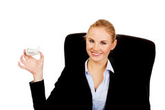 Business woman sitting on wheel chair and holding toy plane Royalty Free Stock Images