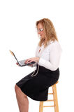 Business woman sitting and working with laptop. Royalty Free Stock Image