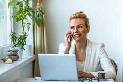 Business woman sitting and working on the laptop in home office. Stock Photography