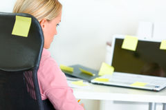 Business woman sitting at workplace with sticker Stock Photo