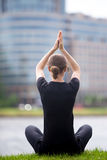 Business woman sitting in yoga pose Stock Photography