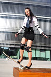 Business woman with skateboard. Business woman in sport outfit with skateboard Royalty Free Stock Photos