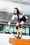 Business woman with skateboard Royalty Free Stock Images