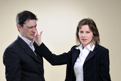Business woman slapping man in office Stock Photography