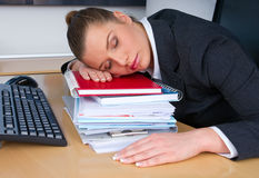 Business woman sleeping. At office desk Royalty Free Stock Photos