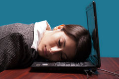 Business woman sleeping. With her head on the laptop's keypad Stock Photos