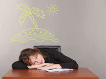 Business woman sleeping at a desk Stock Image