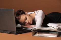 Business woman sleeping in front of laptop. Young business woman sleeping in front of laptop Stock Images