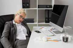 Business woman sleeping in the office Royalty Free Stock Images