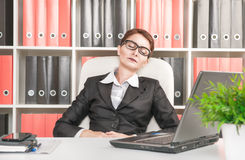 Business woman sleeping in the office Stock Image