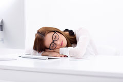 Business woman sleeping on the table Stock Photos