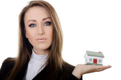 The business woman with small model of the house Royalty Free Stock Photo