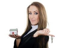 The business woman with small model of the house Stock Images