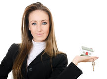 The business woman with small model of the house Royalty Free Stock Photos