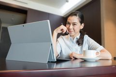 Business woman in smart confident smile sit laptop computer working stock photos