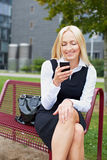 Business woman with smartphone Royalty Free Stock Photography