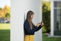 Business woman with smartphone outdoor stock images