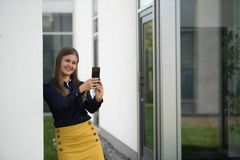 Business woman with smartphone royalty free stock image