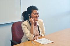 Business woman call to inquire more details and talk. Business woman smile and laugh when calling to inquire more details and talk over phone Royalty Free Stock Image