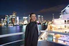 Business woman smile in suit jacket in miami, usa. Sensual woman on ship board on night skyline. Fashion, beauty, look. Travelling. For business. Wanderlust Royalty Free Stock Photos