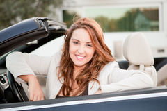 Business woman smiling. On a car Stock Photo
