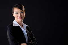 Business woman smiling. On black background Stock Image