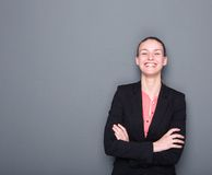 Business woman smiling with arms crossed Royalty Free Stock Photos