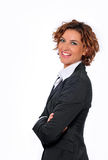 Business Woman Smiling with Arms Folded. Business Woman in a pin striped suit, smiling with arms folded -side view Royalty Free Stock Photography